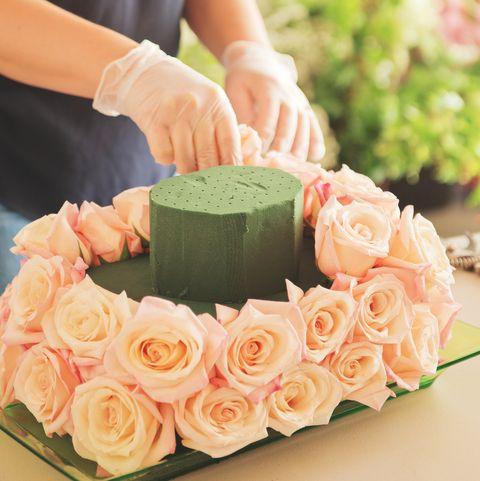 Florist Creating Pink Rose Arrangement