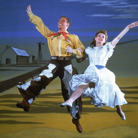 American actor Marc Platt and Russian-born actress Katherine Sergava dance together in a scene from the Broadway musical 'Oklahoma!' at the St. James Theatre, New York, New York, 1943