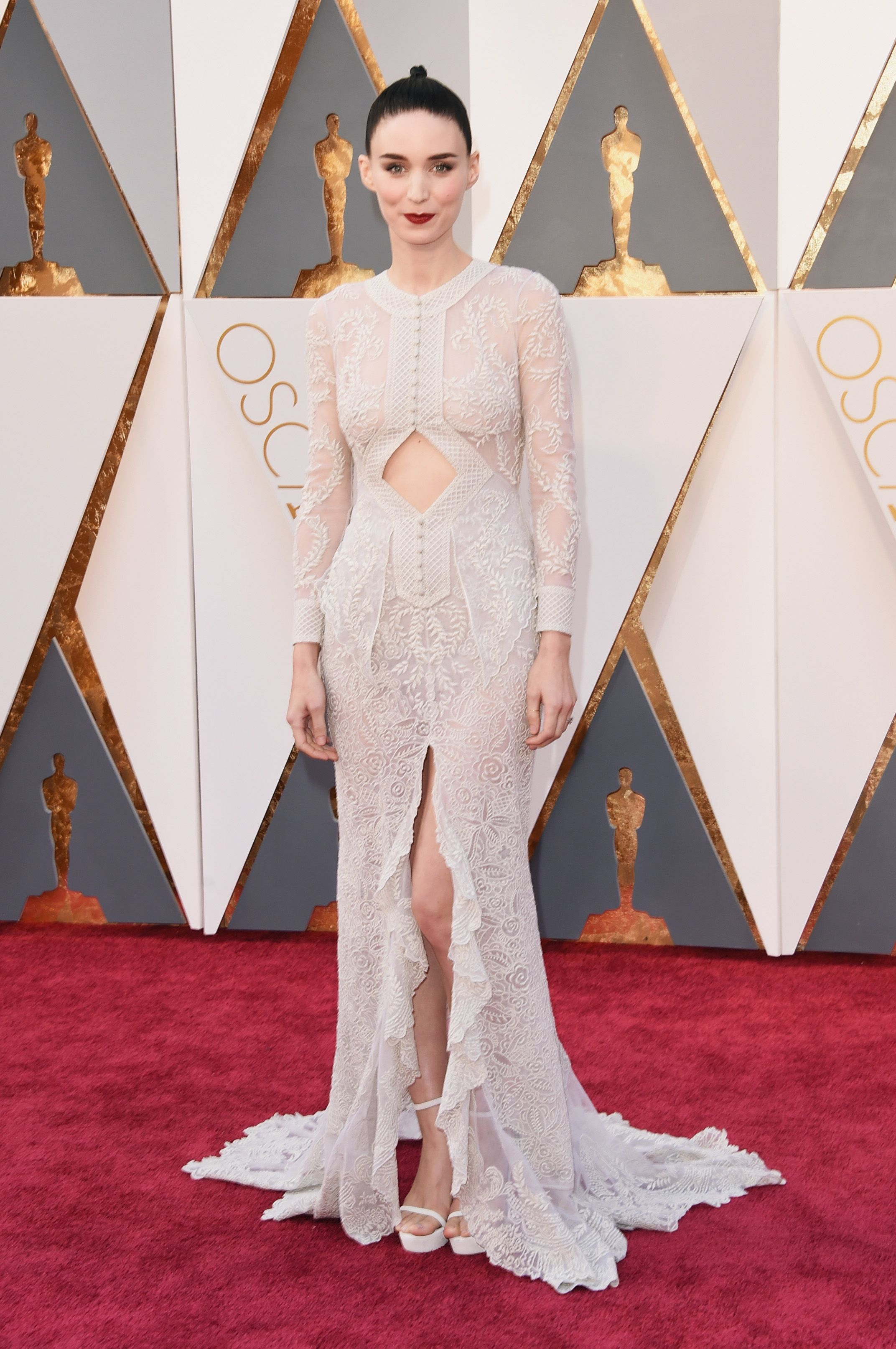 Rooney Mara, 2016 Rooney Mara in lace Givenchy, a.k.a. the dress of our dreams. Her slicked back hair and staple red lip adds to the elegance of the gorgeous sheer number.