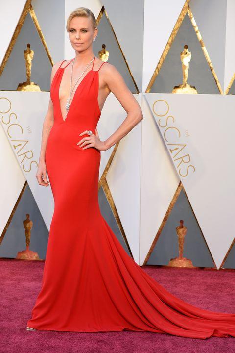Red carpet, Carpet, Dress, Clothing, Gown, Fashion model, Shoulder, Red, Flooring, Fashion,