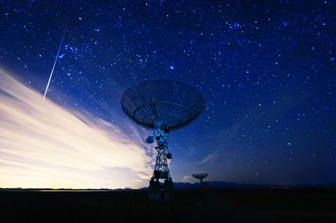 satellite dish under a starry sky