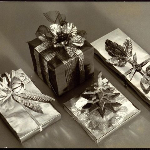 christmas decorations four wrapped presents with leaf, flower, and tree decorations, all by clem hall photo bymartinus andersencondé nast via getty images