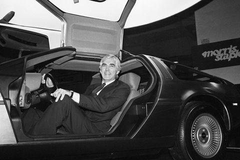 John DeLorean Sitting in Sports Car