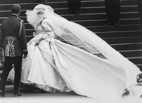 lady diana spencer arrives at st paul's cathedral on her wedding day, revealing to the world the wedding dress which had been carefully guarded during its design