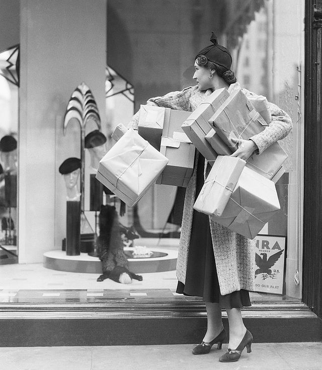 los angeles shoppers take part in william randolph hearsts buy in september campaign which supports president roosevelts national recovery administration program which seeks to stimulate business recovery during the great depression