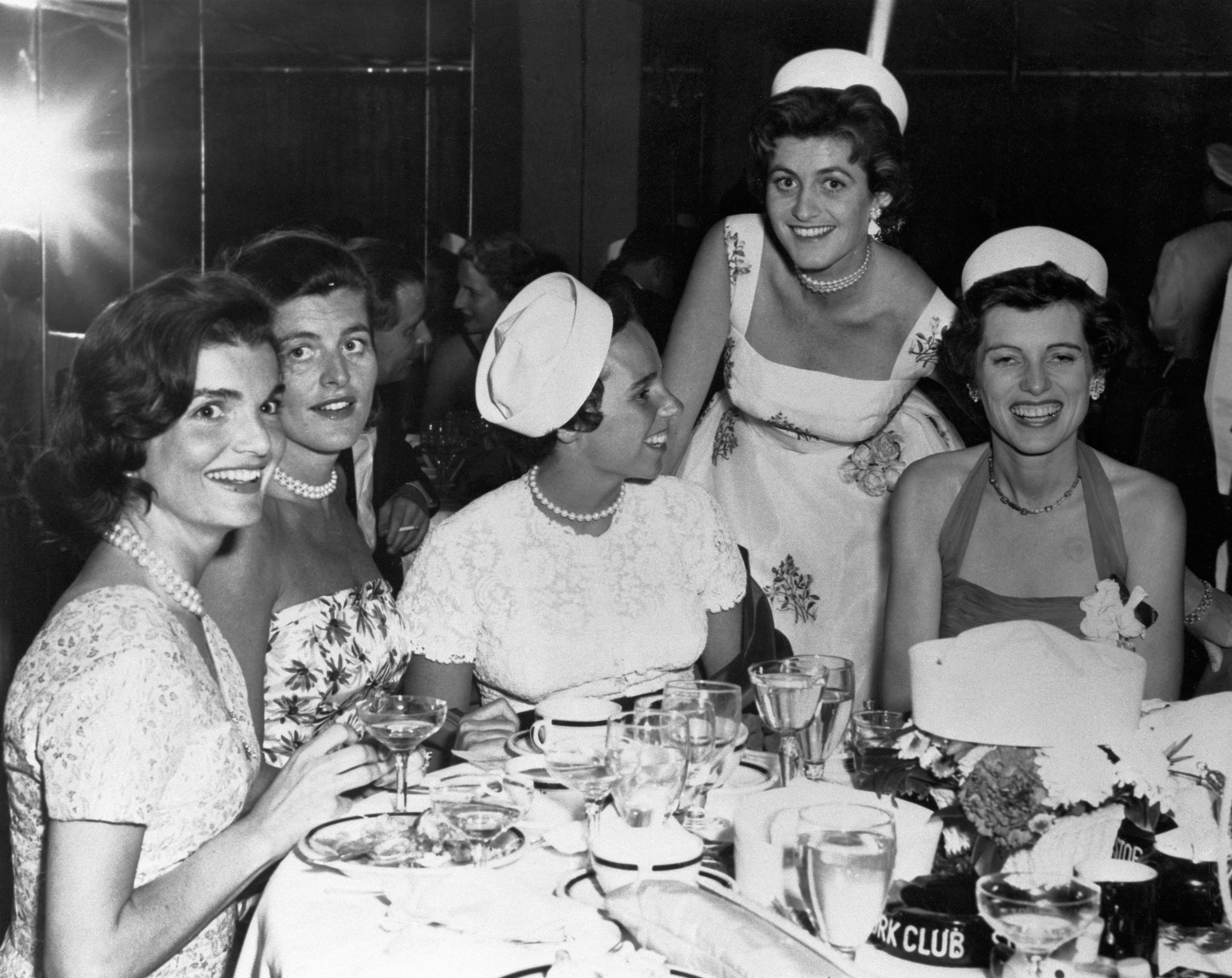 Five Kennedy women—Jackie, Patricia Lawford, Ethel Kennedy, Eunice Shriver, and Jean Kennedy—attend a party.
