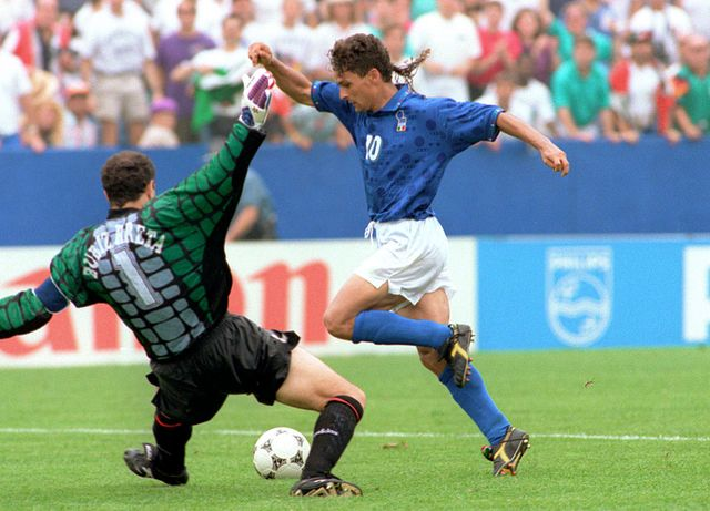 boston,   italian forward roberto baggio r dribbles past spanish goalkeeper andoni zubizarreta to score his teams first goal 09 july 1994 at foxboro stadium in boston during their soccer world cup quarterfinal game italy won 2 1 as baggio scored twice afp phototim clary photo credit should read tim claryafp via getty images