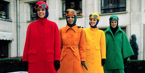 Red, Standing, Orange, Yellow, Fashion, Outerwear, Street fashion, Overcoat, Suit, Trench coat,