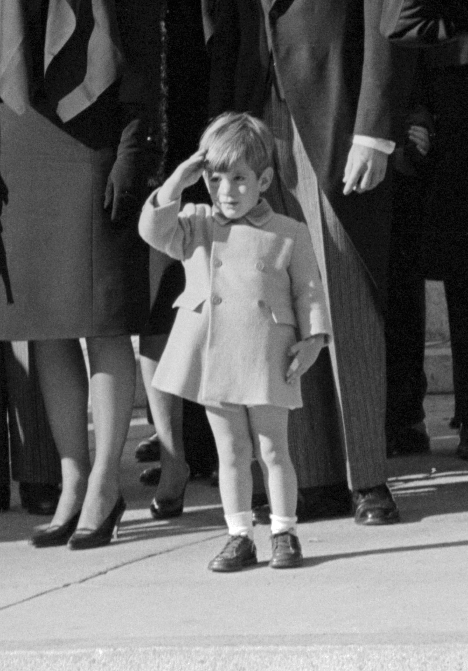 Three-year-old John F. Kennedy Jr. salutes as the casket of his father, the late President John F. Kennedy, as he's carried from St. Matthew's Cathedral in Washington, D.C. on November 25, 1963.