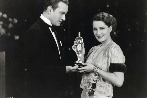 Conrad Nagel Presents Oscar to Norma Shearer