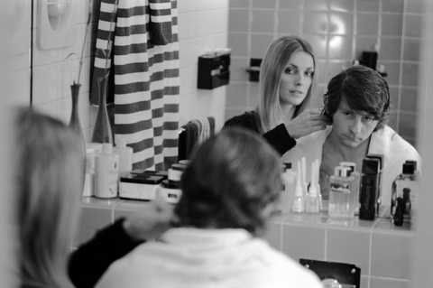 american actress sharon tate 1943   1969 cuts the hair of her husband, polishfrench film director and actor roman polanski, in the bathroom mirror of their home, london, england, 1968 photo by bill raythe life picture collection via getty images