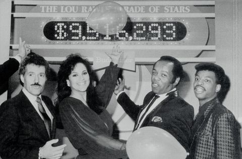 original caption hollywood l r alex trebek, jayne kennedy, lou rawls and levar burton point with pride to the tote board of the seventh annual lou rawls parade of stars telethon as the shows live feed ends late december 28 they money raised will support the education of more than 45,000 students as 45 private, historically black colleges that are part of the united negro college fund the nearly $10 million shown on the board is a preliminary total as additional pledges are expected as the show continues in other cities