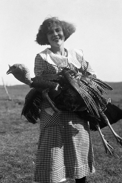 Woman posing with turkey