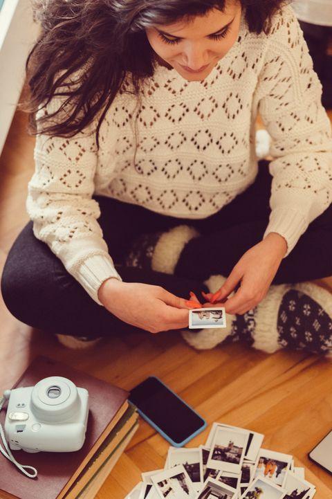 Girl At Home Enjoying Instant Photos