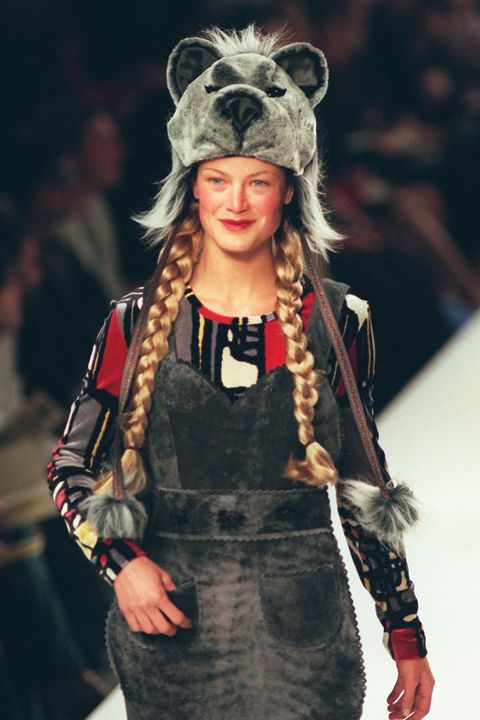 A model wears a bear hat with faux fur pants and a