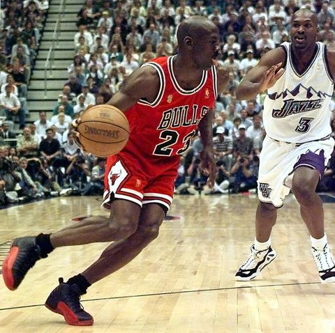 salt lake city, united states  michael jordan l of the chicago bulls goes to the basket past bryon russell of the utah jazz 11 june during game five of the 1997 nba finals at the delta center in salt lake city, utah the best of seven series is tied at 2 2   electronic image     afp photojeff haynes photo credit should read jeff haynesafp via getty images