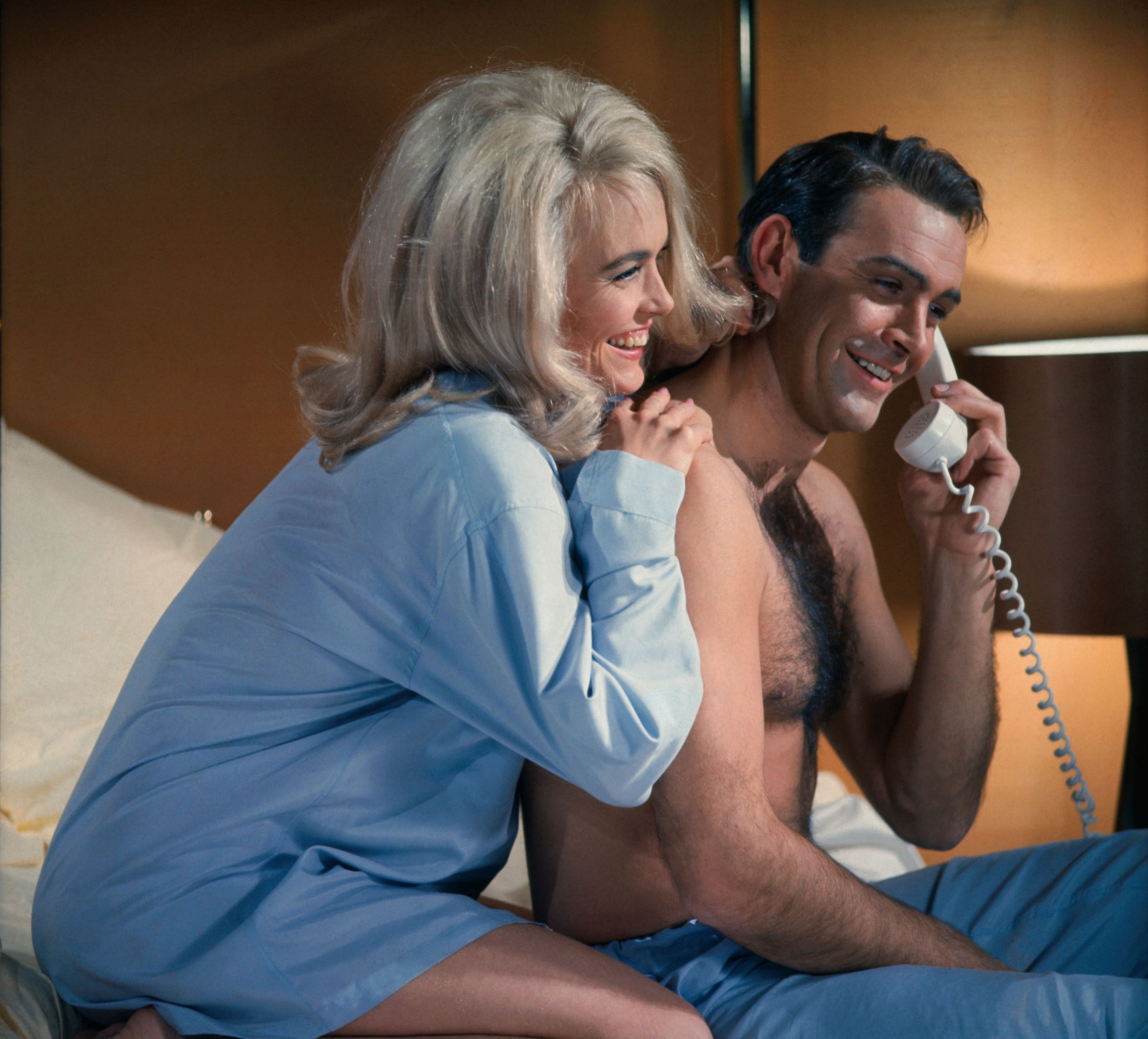 Sean Connery and Shirley Eaton share a laugh on the phone in the Goldfinger.