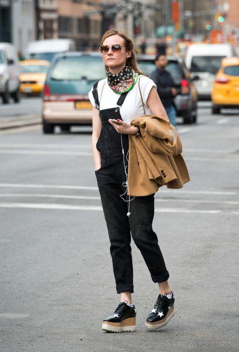 Street fashion, Clothing, Fashion, Footwear, Snapshot, Outerwear, Sunglasses, Yellow, Shoe, Jeans,