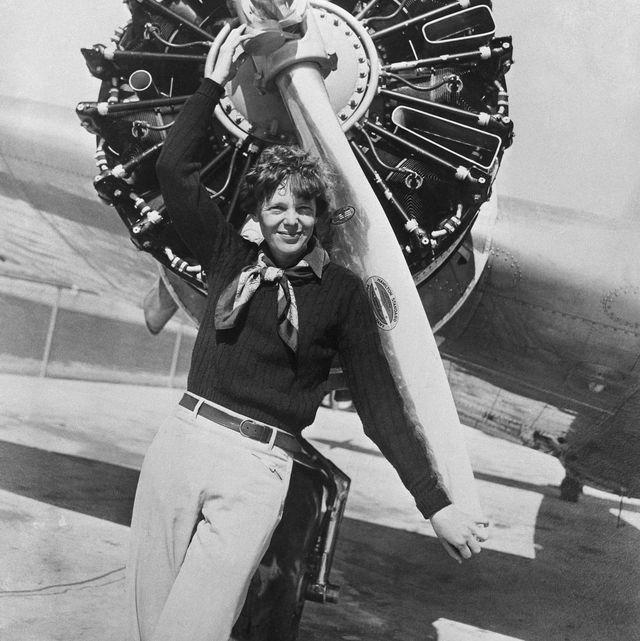 Amelia Earhart Posing Before Her Plane's Propeller