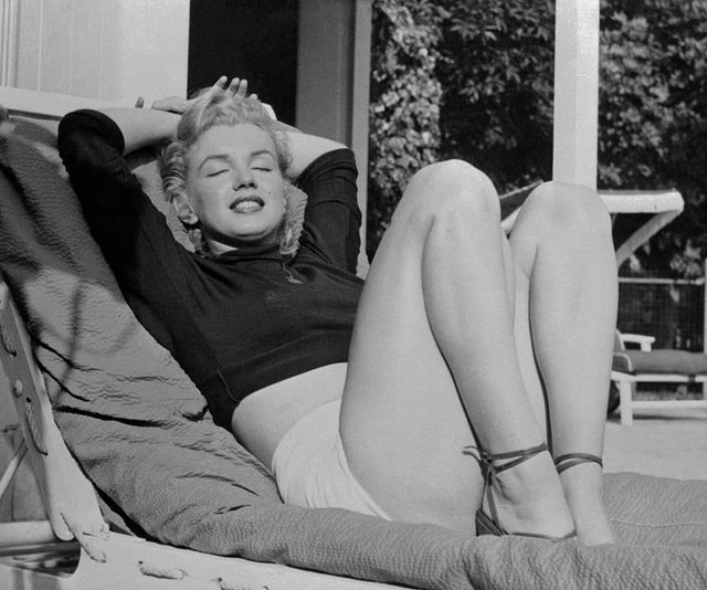 original caption hollywood film star marilyn monroe relaxes on her terrace, looking beautifully content actor hugh marlowe told the voluptuous actress that she neednt worry becuase shes being typed as a sexy girl marlowes theory is that one only becomes a real success when youre a specialist, so marilyn is lucky to be born that way whether marilyn is typed or not, she surely doesnt look worried