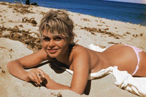 Photograph, Vacation, Beach, Sun tanning, Summer, Sand, Beauty, Skin, Fun, Sea,