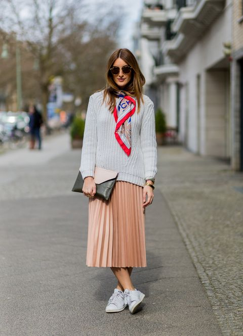 berlin, germany   march 29 fashion blogger sofia grau is wearing a salmon pink skirt from zara, white sneakers from adidas, a grey sweater from mango, a pink black clutch from lancel paris, a red grey scarf from chanel, sunglasses from rayban clubround, watch kapten  son on march 29, 2016 in berlin, germany photo by christian vieriggetty images
