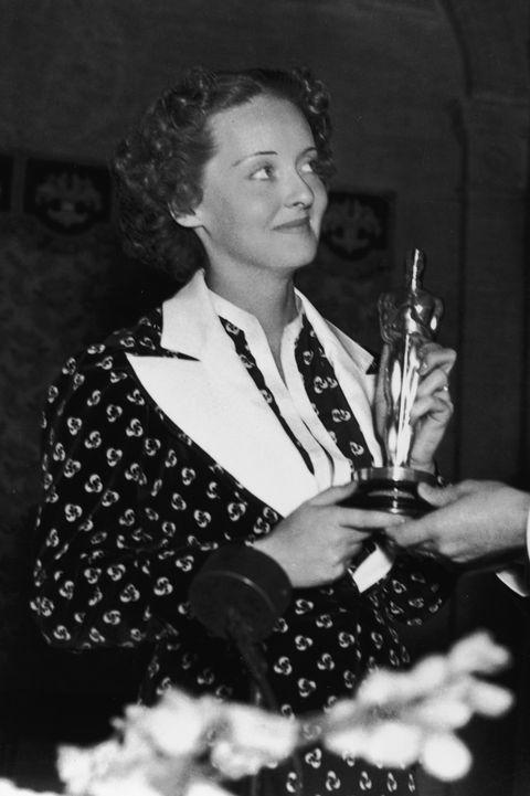 Davis And Warner Hold Davis' Best Actress Oscar