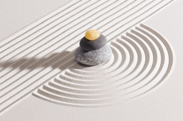 japan garden with stone of meditation in raked sand