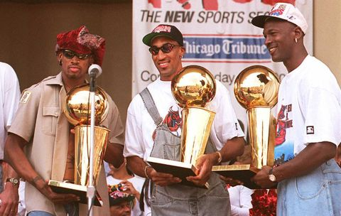 chicago, il   june 18  chicago bulls players dennis rodman l, scottie pippen c and michael jordan r hold three of the teams four recent larry obrien trophies 18 june at a rally for the team in grant park in chicago  thousands of fans crowded into the park to see the nba champions  photo credit should read tim zielenbachafp via getty images