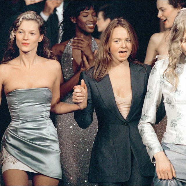 British top models Kate Moss (L), Naomi Campbell (