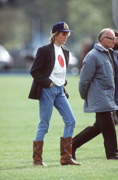 Jeans, Riding boot, Footwear, Street fashion, Outerwear, Headgear, Boot, Shoe, Jacket, Trousers,