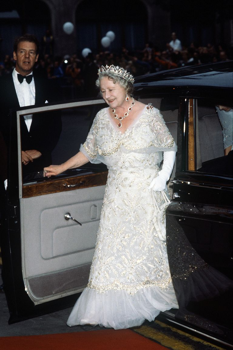 Queen Elizabeth, the Queen Mother, wore a white chiffon evening gown to her 80th birthday celebration in 1980. She paired the gown with a stunning tiara and necklace set.