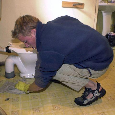 William Cleaning Toilet