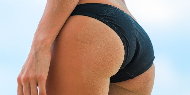 sexy ladys ass on the beach in the sand