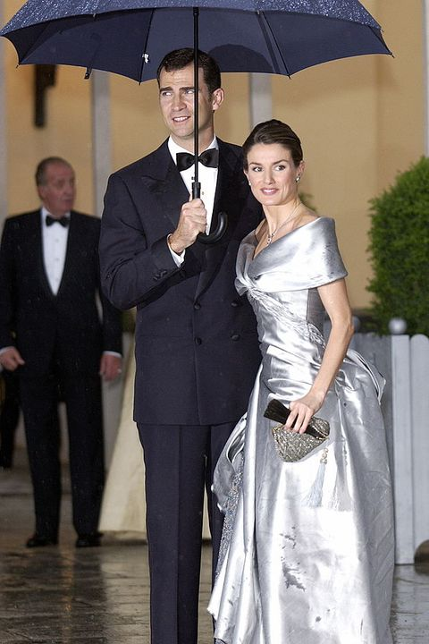 Suit, Formal wear, Facial expression, Gown, Clothing, Dress, Fashion, Event, Tuxedo, Wedding dress,