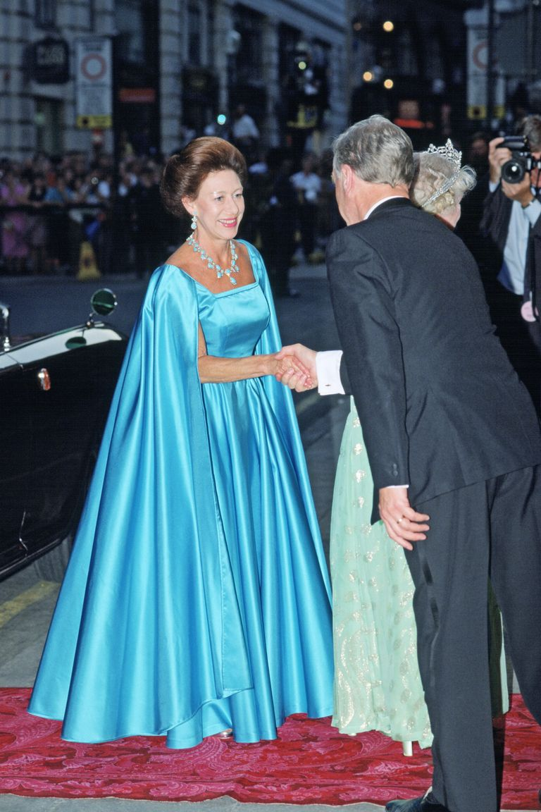In the summer of 1990, Princess Margaret was on hand to celebrate the Queen Mother's 90th birthday at the London Palladium. She wore this icy-blue number for the occasion, along with a blue necklace and earrings.