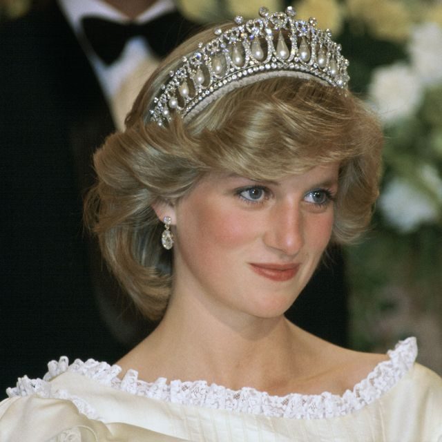new zealand   april 29  princess diana at a banquet in new zealand wearing the cambridge knot tiara  queen marys tiara   with diamond earrings her cream silk organza evening dress is designed by fashion designer gina fratini  photo by tim graham photo library via getty images