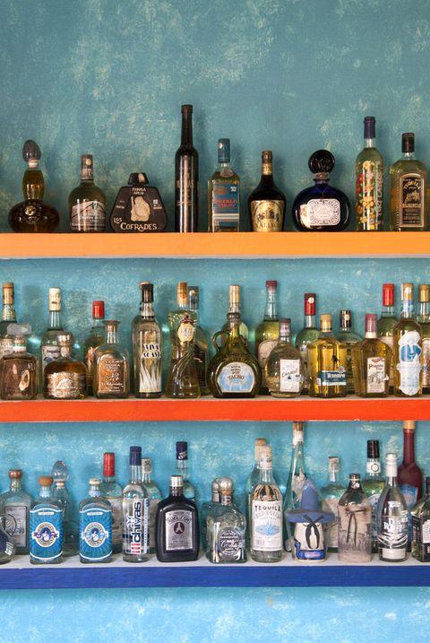 Bottle, Glass bottle, Alcohol, Liqueur, Distilled beverage, Drink, Shelf, Alcoholic beverage, Collection, Shelving,