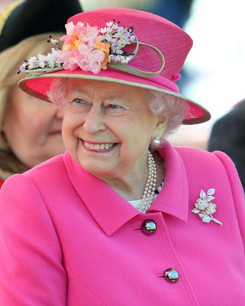 Pink, Hat, Fashion accessory, Headgear, Costume hat, Fun, Tradition, Magenta, Smile,