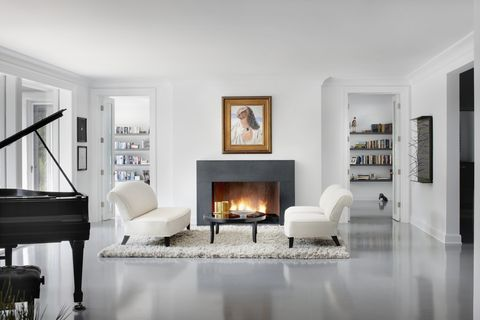modern family room with glowing fireplace and grand piano in this chicago il residence