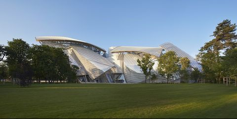 Architecture, Sport venue, Stadium, Sky, Grass, Technology, Building, House, Headquarters, Lawn,