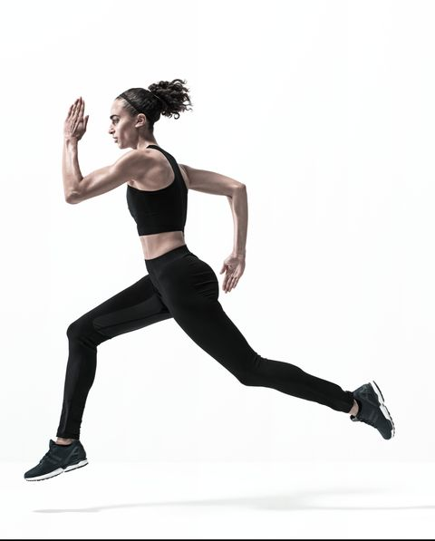 Young woman running fast on white background