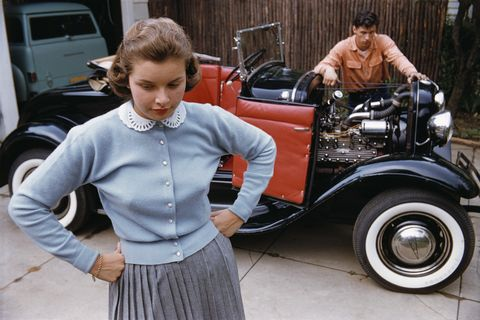 Adolescent Couple Separated by Roadster