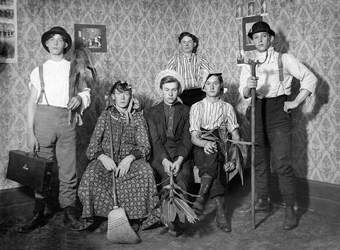 Teenage boys all dressed up in costumes, ca. 1905.