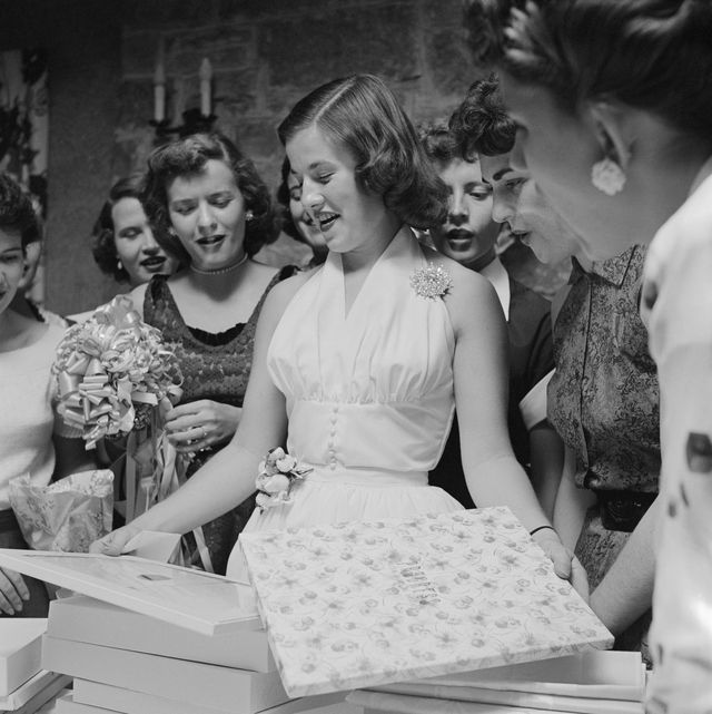 bride opening gifts at a bridal shower photo by genevieve naylorcorbis via getty images