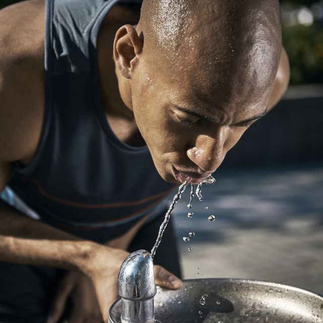 male athlete drinking water