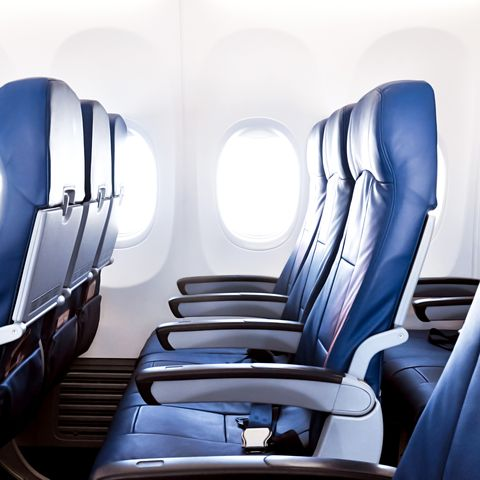 Blue, Airline, Head restraint, Massage chair, Air travel, Automotive design, Office chair, Vehicle, Chair, Room,