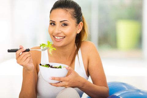model eating salad
