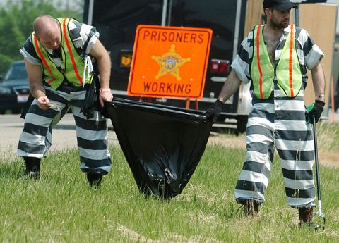 Prisoners pick up trash as part of the B