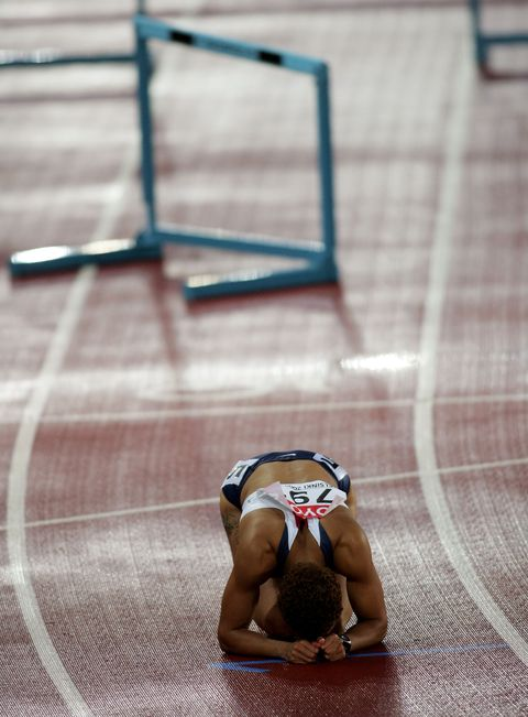 helsinki, finland   august 11  joanna hayes of usa reacts after she fell over the hurdle during the womens 100 metres hurdles final at the 10th iaaf world athletics championships on august 11, 2005 in helsinki, finland brigitte michelle perry of usa won gold  photo by michael steelegetty images